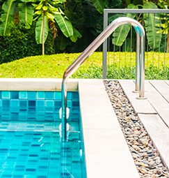 Clean swimming pool with ladder